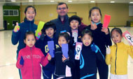 Coach and figure skaters from South Korea with Skate Spinner